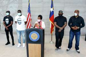U.S. Congresswoman Sheila Jackson Lee, center, makes a formal statement regarding the murder of former Houstonian George Floyd with Xavier Roberson, from let, Brandon Williams, rapper Trae tha Truth and Pastor Patrick Ngwolo in Houston on Saturday, May 30, 2020.