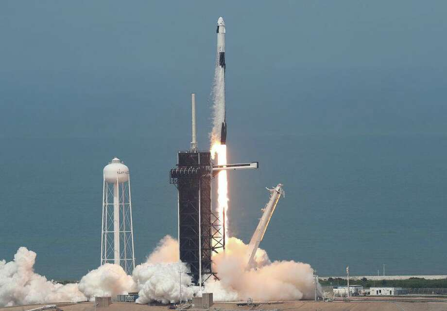 The SpaceX Falcon 9 rocket with the manned Crew Dragon spacecraft attached takes off from launch pad 39A at the Kennedy Space Center in Florida. Photo: Joe Raedle/Getty Images
