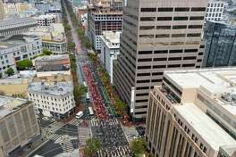 People march down Market Street in San Francisco on Saturday, May 30, 2020 to protest the killing of George Floyd.