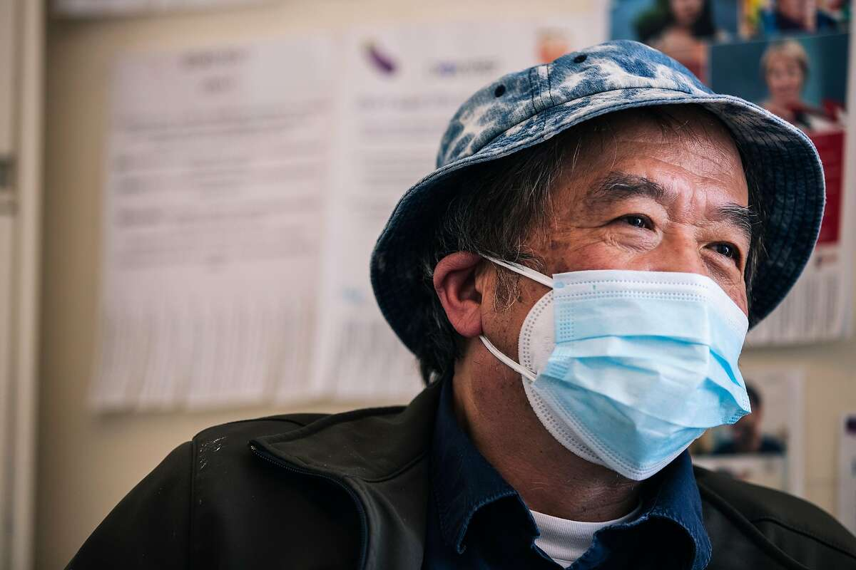 Gene Qin, 72, who tested positive for the COVID-19 novel coronavirus from his vacation aboard the Grand Princess cruise ship in early March, reacts while being interviewed during a baseline visit to participate in UCSF's Long-term Impact of Infection with Novel Coronavirus (LIINC) study to better understand the virus' effect on the human body after recovery, at the Zuckerberg San Francisco General Hospital and Trauma Center in San Francisco, Calif. on Friday, May 22, 2020.