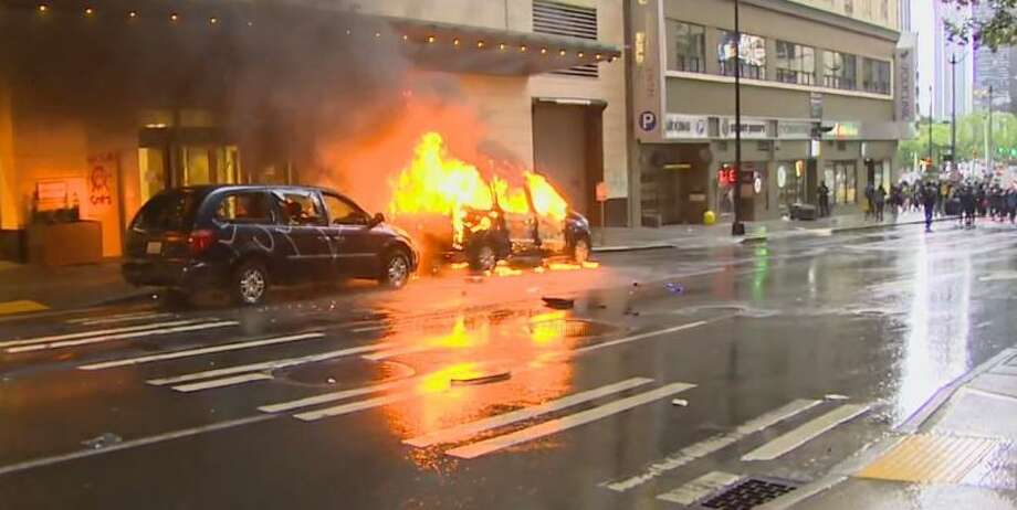 A vehicle burns during a protest of George Floyd's death in downtown Seattle on May 30, 2020. Photo: KOMO News