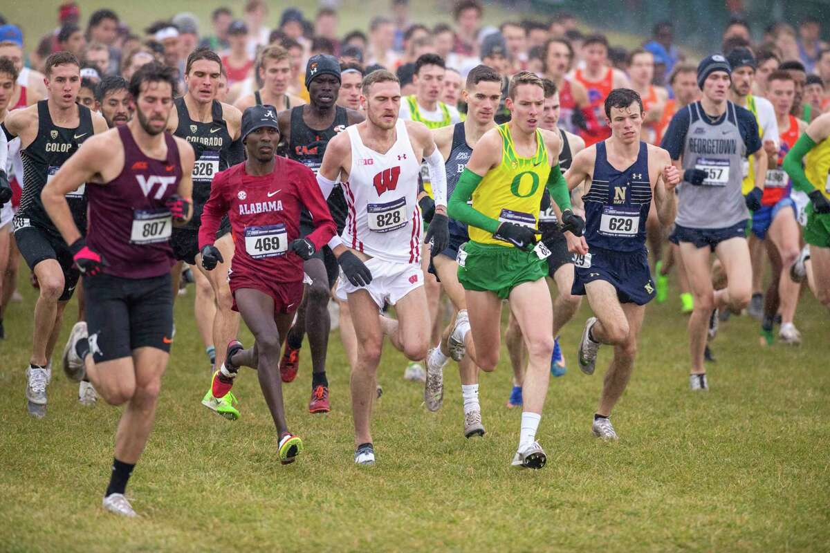 FILE - In this Nov. 23, 2019, file photo, runners compete in the men's NCAA Division I Cross-Country Championships in Terre Haute, Ind. Four-year colleges facing budget shortfalls stemming from the coronavirus outbreak have eliminated a total of nearly 100 sports programs since March. (AP Photo/Doug McSchooler, File)