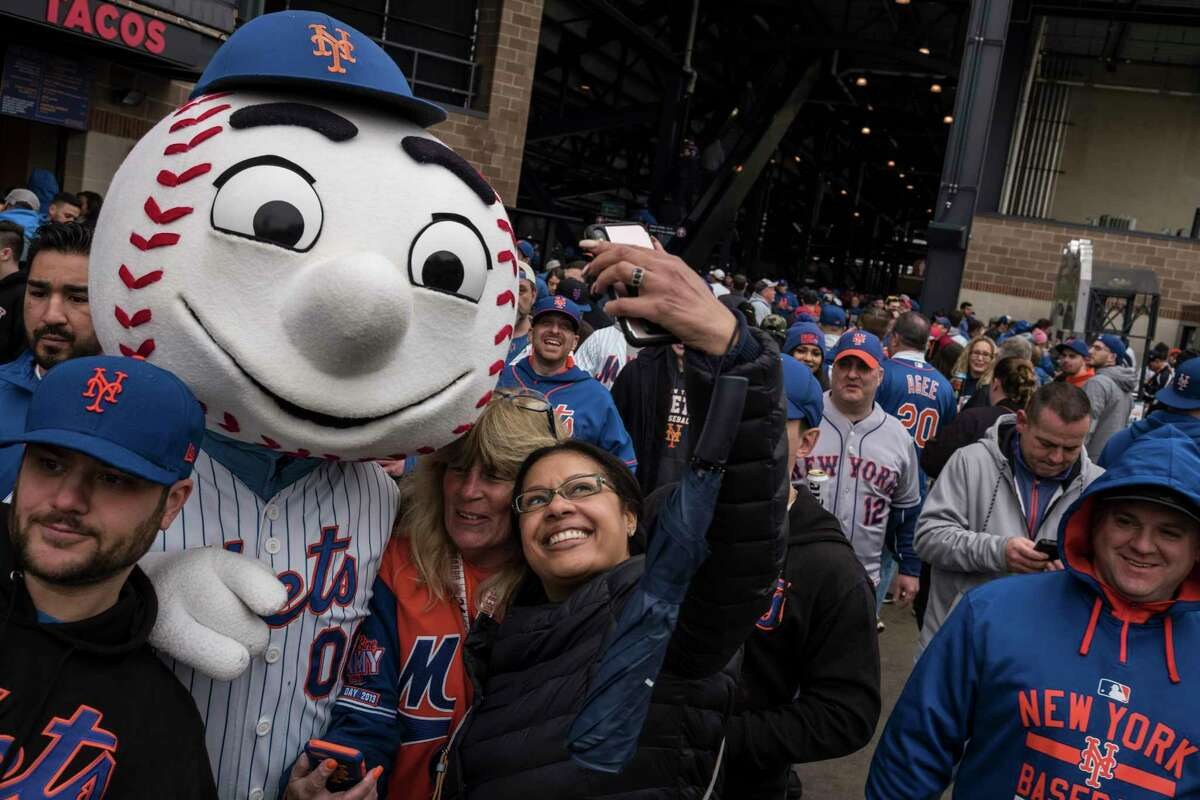 Mr. Met, the New York Mets mascot, mingles with fans at Citi Field for an opening day game against the St. Louis Cardinals in New York, March 29, 2018. (Todd Heisler/The New York Times)