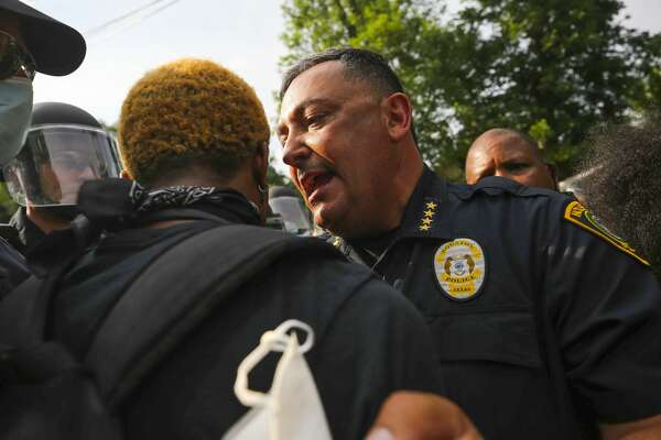 Houston police chief Art Acevedo talks with protestors during an ongoing rally for George Floyd, a Houston native who died in custody of the Minneapolis police earlier this week, during ongoing demonstrations Saturday, May 30, 2020 in Houston.
