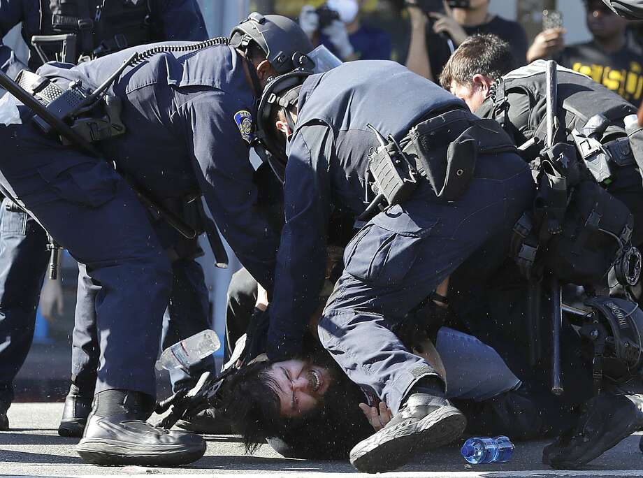 San Jose police subdue a protestor prior to arresting him on Friday, May 29, 2020, in San Jose, Calif. (AP Photo/Ben Margot) Photo: Ben Margot / Associated Press