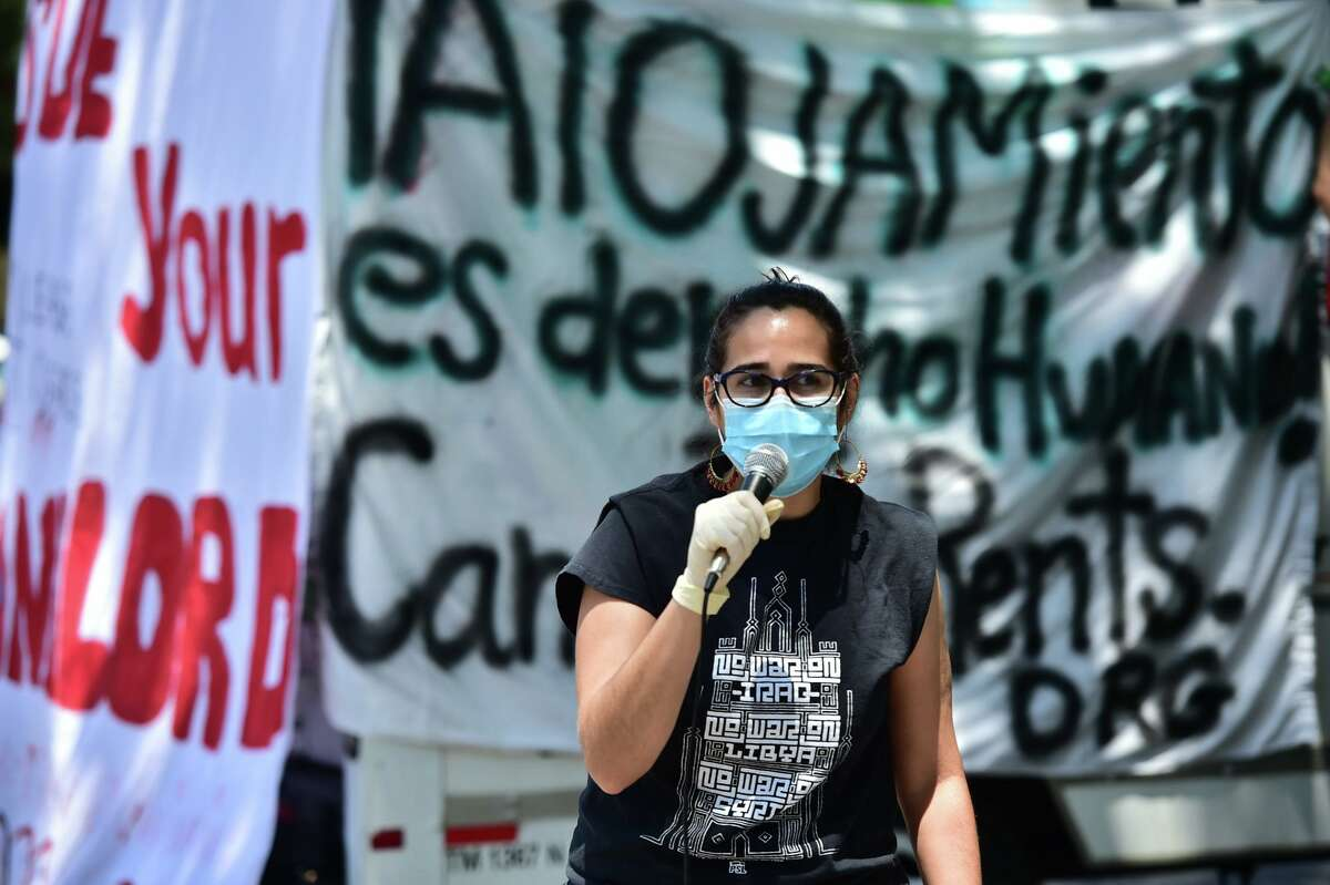 Rachell Tucker of the Party for Socialism and Liberation speaks to participants in a protest caravan on South Flores.