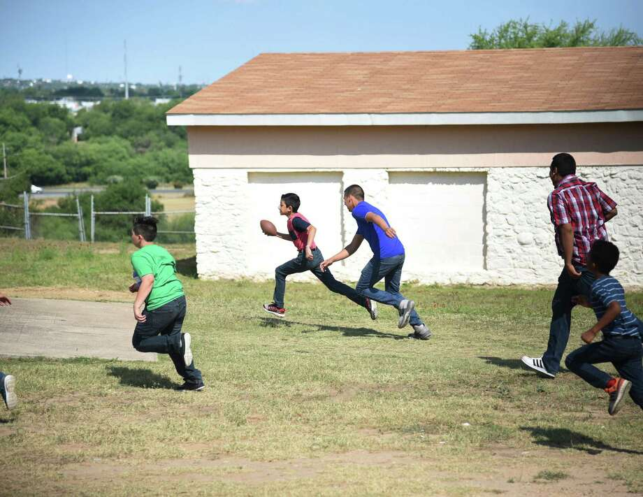 A game of football with Malicious Motorsport members is being played during the Border Skullz BBQ at Sacred Hearts Children's Home in 2018. Photo: Christian Alejandro Ocampo /Laredo Morning Times File / Laredo Morning Times