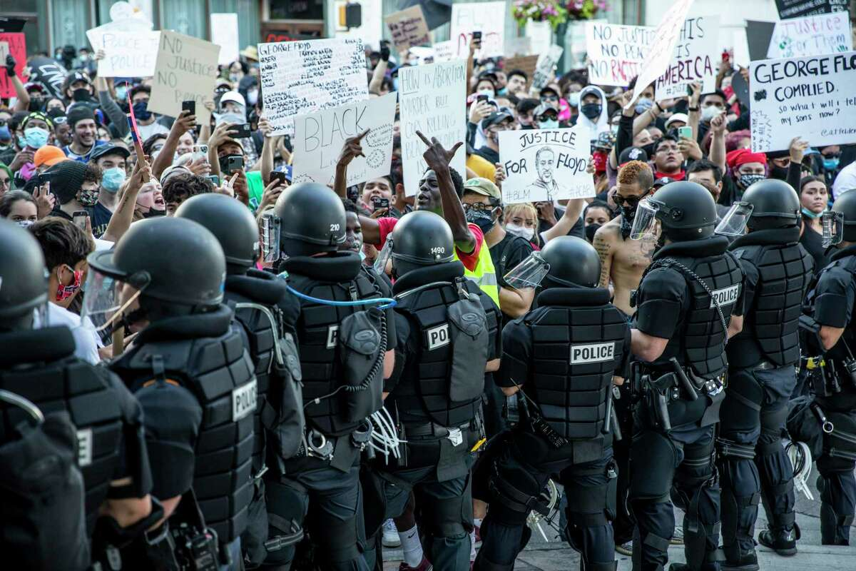 People protested in front of the Alamo in downtown San Antonio on Saturday May 30, 2020, to protest the killing of George Floyd in Minnesota while he was in police custody.