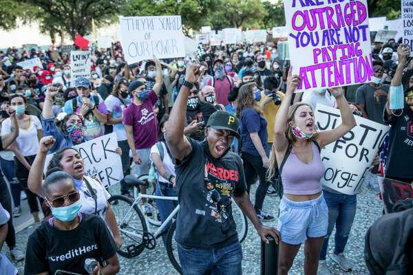 People rallied in front of the San Antonio Police Headquarters to protest the killing of George Floyd.