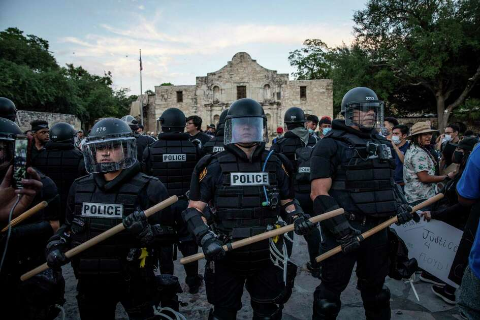 San Antonio Police officers deploy in front of the Alamo in downtown San Antonio, Texas, U.S. on Saturday, May 30, 2020. People took to the streets of San Antonio to protest the killing of George Floyd in Minnesota while he was in police custody.