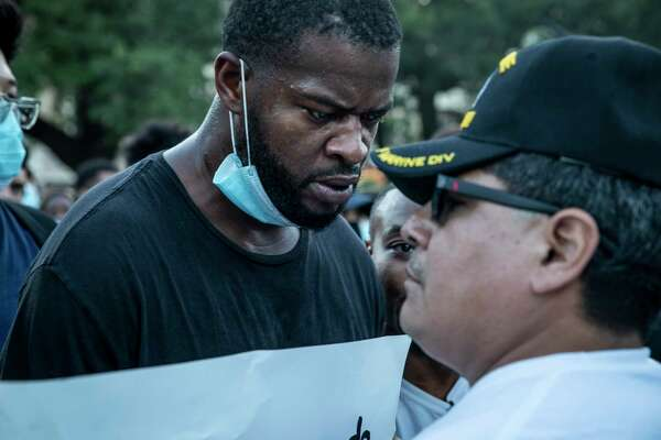 Angers flared as protestors confronted military-style groups in front of the Alamo in downtown San Antonio, Texas, U.S. on Saturday, May 30, 2020 to protest the killing of George Floyd in Minnesota while he was in police custody.
