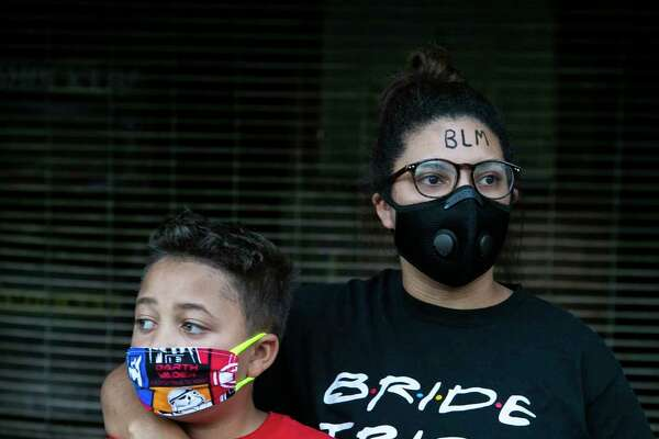 Daeja Lewis, 24, and her brother Jonathan Lewis, 9, pose together during a protest to honor George Floyd.
