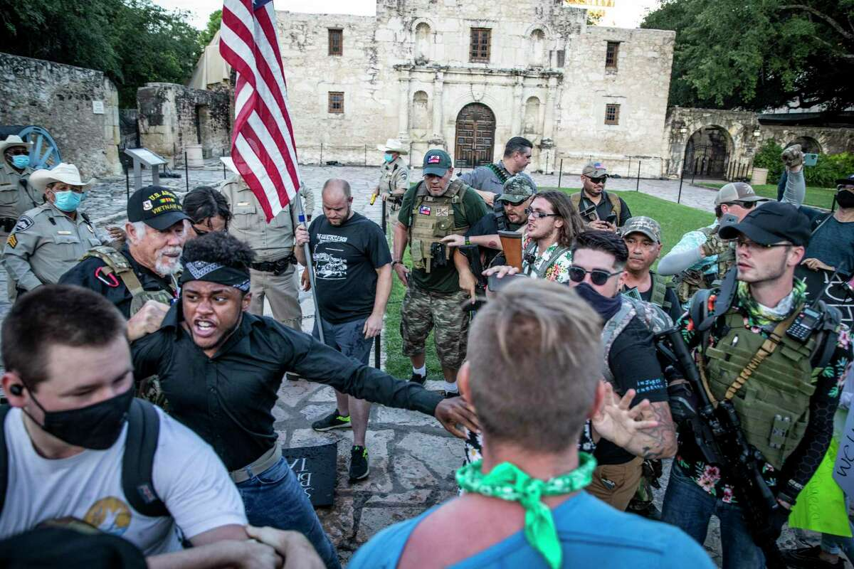 Protestors and military-style groups began pushing each other in front of the Alamo in downtown San Antonio on Saturday, May 30, 2020. People took to the streets of San Antonio to protest the killing of George Floyd in Minnesota while he was in police custody.