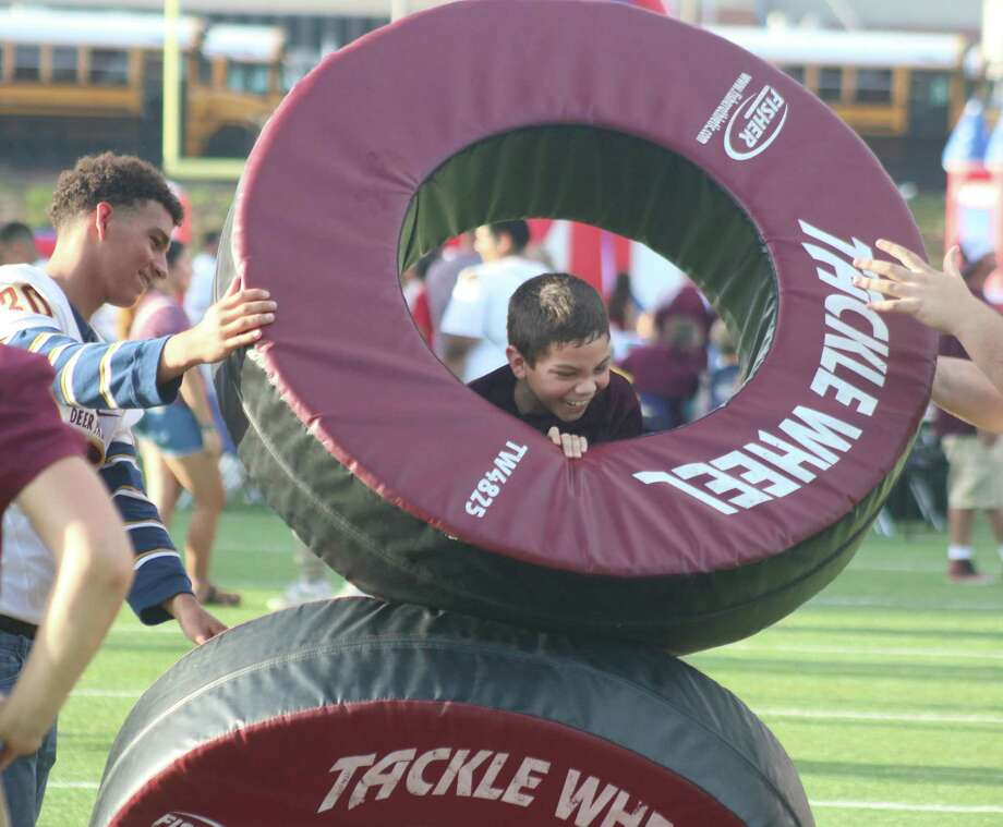 Kids and adults alike have come to love the Deer Park football program's popular Meet the Team Night. It's still scheduled to take place but the window will begin closing pretty soon. Photo: Robert Avery