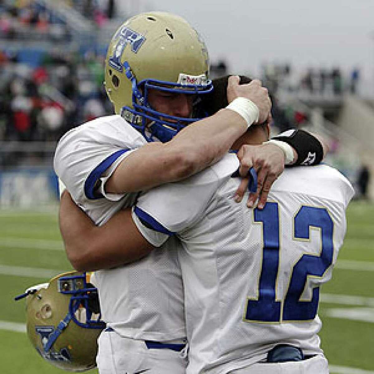 Kerrville Tivy's Johnny Manziel (left) consoles teammate Braedon White after losing 31-21 to Brenham in Georgetown.