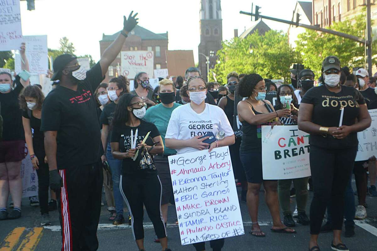 Hundreds joined a Black Lives Matter procession down Main Street in Middletown May 30. At center is organizer Erica Hunter.