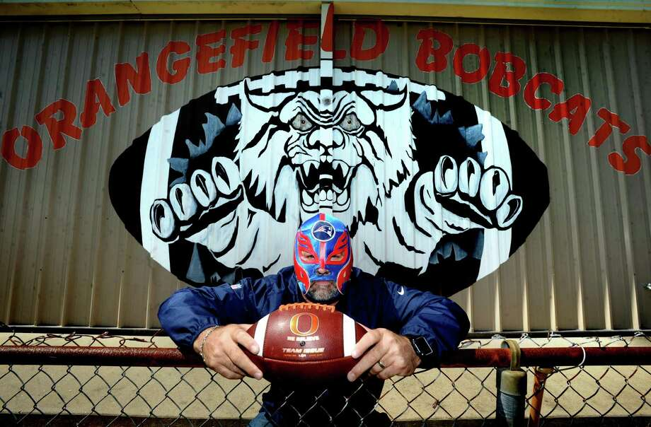 Orangefield coach Josh Smalley has tried to bring a little levity in dark times, transforming into El Patriota as he videos himself tending to the grounds and athletic facilities at the high school. A long-time New England Patriots fan, he'd received a gift of a Patriot's themed wrestling mask from a friend who'd found it during a trip to Cabo. He says he'll probably never hear the end of his in-character posts mid-quarantine, but if it makes somebody laugh while dealing with this, it's worth it. Photo taken Tuesday, May 19, 2020 Kim Brent/The Enterprise Photo: Kim Brent / The Enterprise / BEN