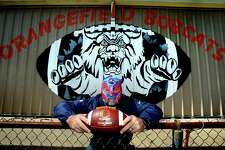 Orangefield coach Josh Smalley has tried to bring a little levity in dark times, transforming into El Patriota as he videos himself tending to the grounds and athletic facilities at the high school. A long-time New England Patriots fan, he'd received a gift of a Patriot's themed wrestling mask from a friend who'd found it during a trip to Cabo. He says he'll probably never hear the end of his in-character posts mid-quarantine, but if it makes somebody laugh while dealing with this, it's worth it. Photo taken Tuesday, May 19, 2020 Kim Brent/The Enterprise