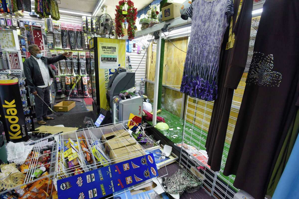 A view inside the Top Quality Discount store on Central Ave. on Sunday, May 31, 20202, in Albany, N.Y. People smashed the large front windows of the store Saturday night and stole all the items in the display window. (Paul Buckowski/Times Union)