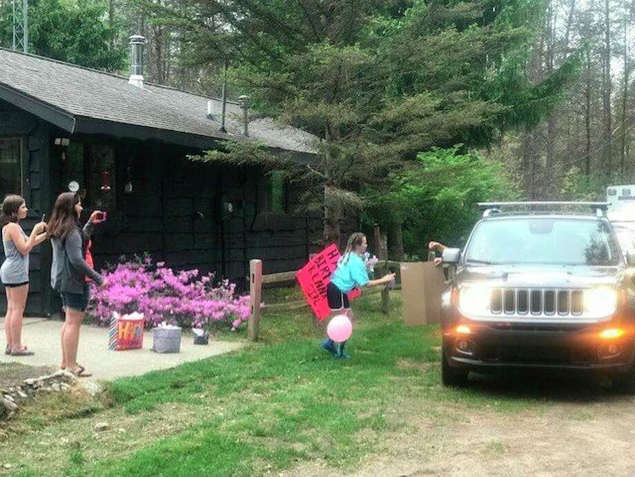 MacKenna Wardie of Wellson was given a parade for her 12th birthday by the Norman Township Fire Department, the Department of Natural Resources and friends. She is shown getting some gifts from people in the parade. (Courtesy photo)