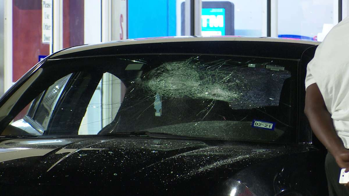A Houston police officer was hit by a car Saturday as the driver of the vehicle was fleeing a fight in a gas station parking lot, police said.