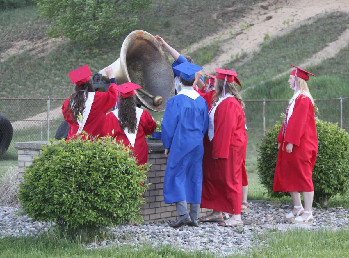 Manistee Catholic Central held its commencement ceremony for 10 graduates on Saturday at Saber Stadium in Manistee. Prior to the ceremony, family and community members honored the graduates with a procession through the school parking lot.