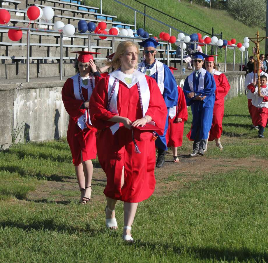 Manistee Catholic Central held its commencement ceremony for 10 graduates on Saturday at Saber Stadium in Manistee. Prior to the ceremony, family and community members honored the graduates with a procession through the school parking lot. Photo: Ken Grabowski/News Advocate
