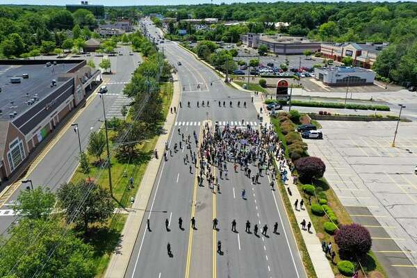 Protesters close Connecticut Avenue in Norwalk on Sunday, May 31, 2020.