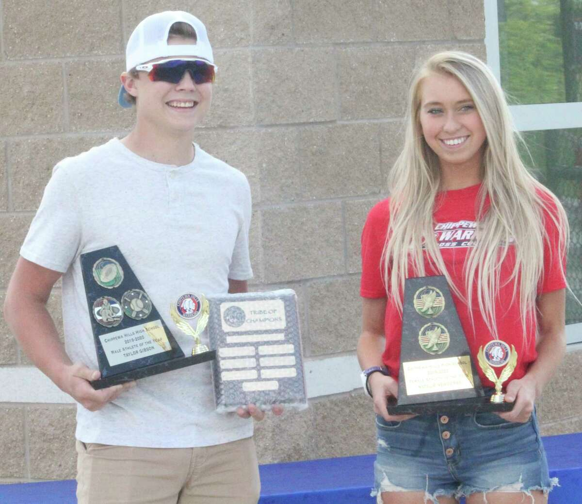 Natalie Newcombe (right) and Taylor Gibson were honored as Chippewa Hills Female and Male Athletes of the Year on Friday. (Pioneer photo/John Raffel)