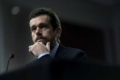 FILE -- Jack Dorsey, chief executive of Twitter, appears before the Senate Intelligence Committee in Washington on Sept. 4, 2018. Inside the company, one faction wanted Dorsey to take a hard line against the President Donald Trump's tweets while another urged him to remain hands-off.