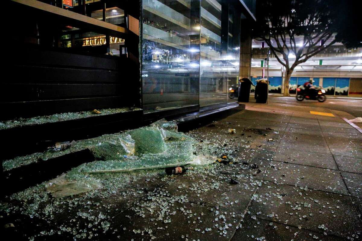 Executive Order Bar & Lounge is looted on Saturday in San Francisco. Protests in the Bay Area and the nation continued following the death of George Floyd, who died after being restrained by Minneapolis police officers on Memorial Day.
