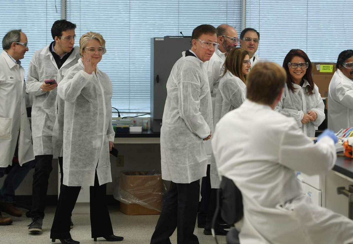 Governor Ned Lamont and Lt. Governor Susan Bysiewicz tour the lab at Protein Sciences Corp. in Meriden, Conn. on Thursday, March 12, 2020. The company is working on a vaccine for the coronavirus.