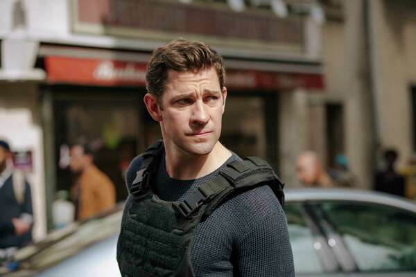 "This image released by Amazon shows John Krasinski in a scene from ""Tom Clancy's Jack Ryan."" (Jan Thijs/Amazon via AP)"
