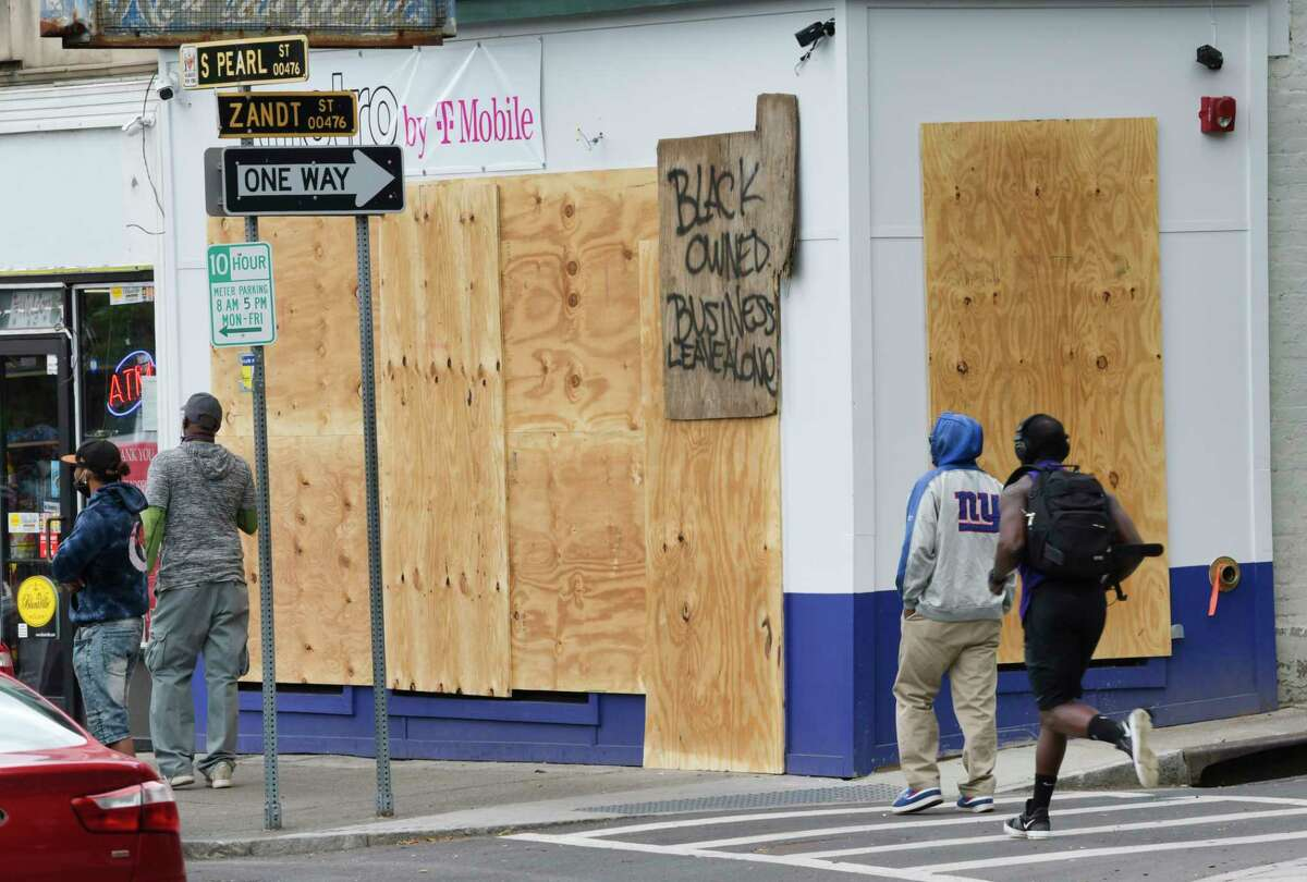 A mobile phone store's windows are boarded up on Sunday, May 31, 20202, in Albany, N.Y. (Paul Buckowski/Times Union)