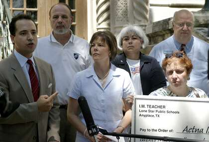 The San Antonio Alliance of Teachers and Support personnel, and the Bexar County Federation of Teachers and their supporters hold a press conference in 2004 on the steps of City Hall to protest new health reimbursement arrangements for Texas school employees. State Rep. Jose Menendez, left, is joined by Tom Cummins, Shelley Potter, Rachel Martinez, Patsy Esterline and J. B. Richeson
