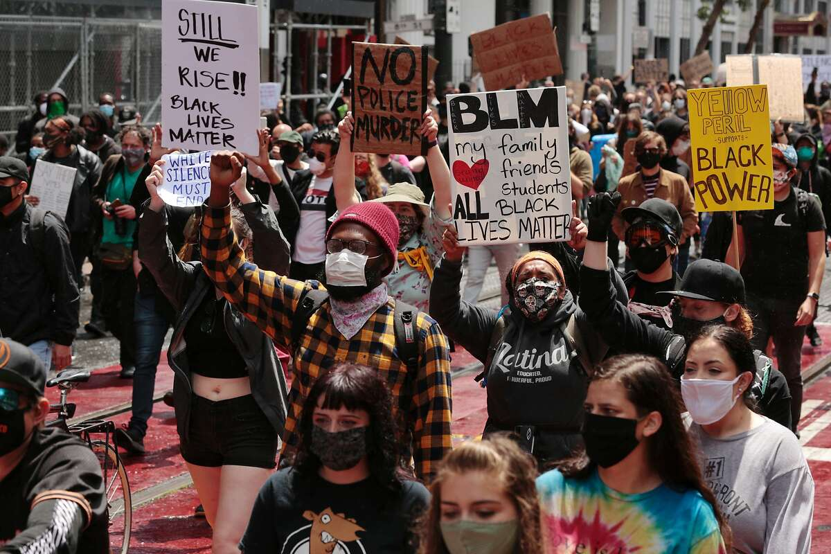 Protesters march along Market Street after a rally at City Hall on Saturday, May 30, 2020, in San Francisco, Calif. Protesters continued following the death of George Floyd, who died after being restrained by Minneapolis police officers on Memorial Day.