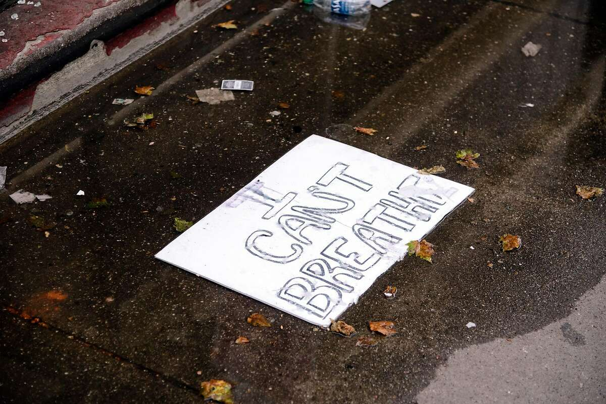 A signs is seen in the street following overnight George Floyd protest in Oakland, Calif, on Saturday, May 30, 2020.