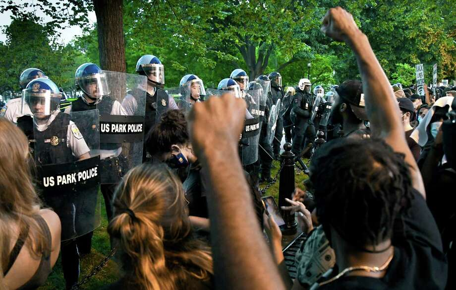 Police officers confront protesters near Lafayette Square in Washington, D.C., on Saturday. In several other cities across the country, journalists reported being physically confronted or arrested by police while they tried to cover the protests. Photo: Washington Post Photo By Michael S. Williamson / 2020 The Washington Post