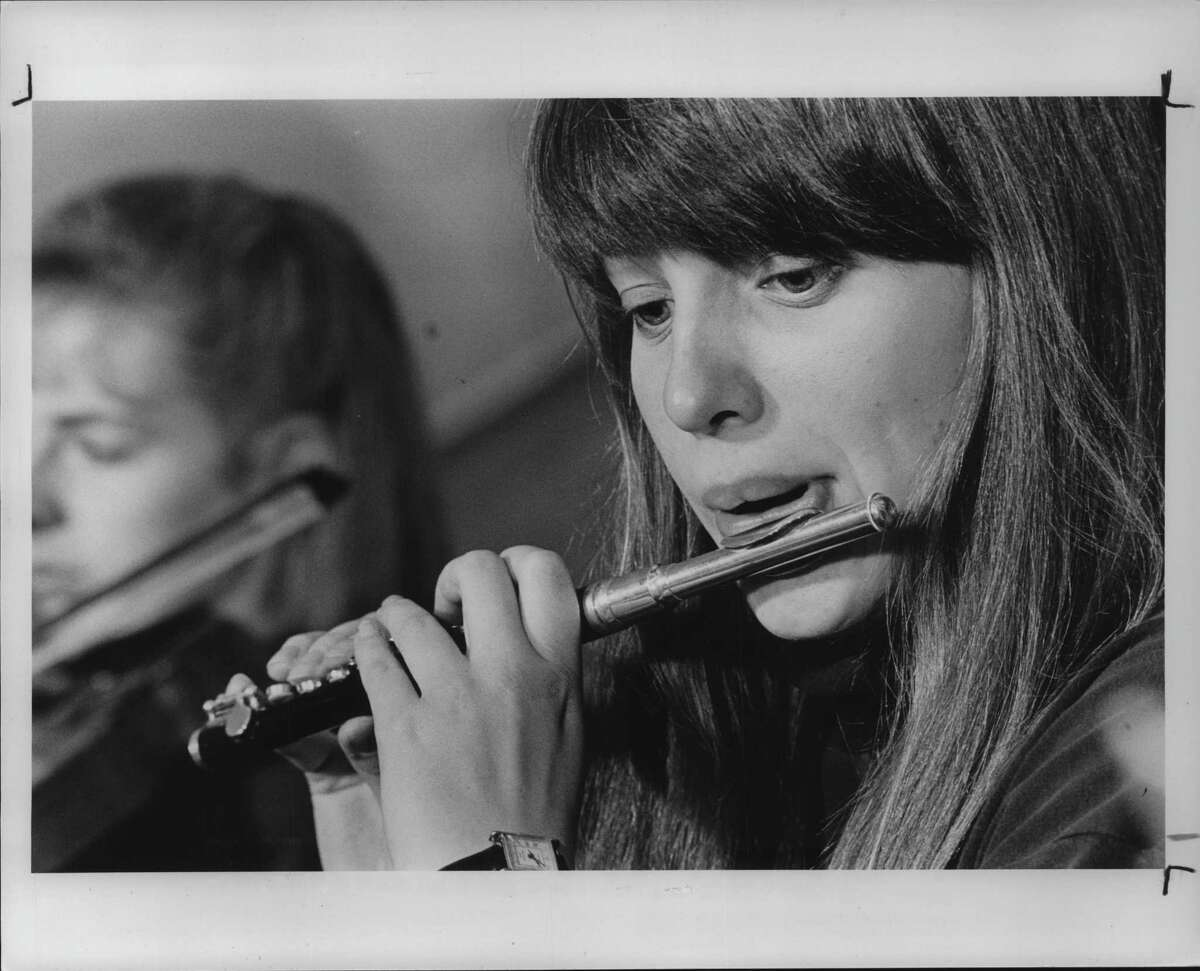 Kate Anderson, Grade 12, Shaker, plays the flute during an ESYO concert,. June 1, 1990 (Times Union Archive)