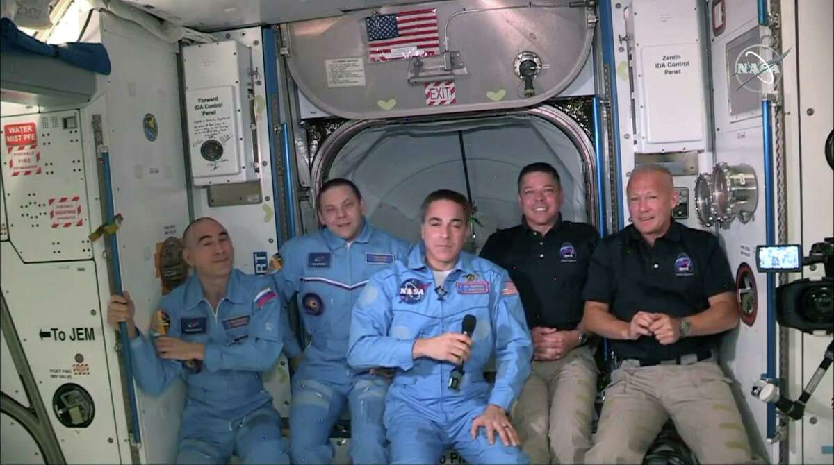 INTERNATIONAL SPACE STATION - MAY 31: In this screen grab from NASA's feed, NASA astronauts Doug Hurley (right) and Bob Behnken (second from right) join NASA astronaut Chris Cassidy (center) and Russian cosmonauts, Anatoly Ivanishin (left) and Ivan Vagner (second from left) aboard the International Space Station after successfully docking SpaceX's Crew Dragon capsule May 31, 2020. (Photo by NASA via Getty Images)