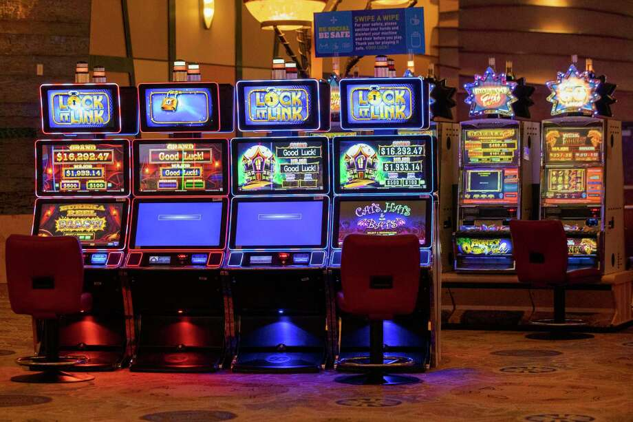 Disabled slot machines to ensure proper social distancing are seen next to working ones at the Mohegan Sun casino, Thursday, May 21, 2020, in Uncasville, Conn. Connecticut's two federally recognized tribes, Mashantucket Pequot and Mohegan tribes, said they're planning to reopen parts of their southeastern Connecticut casinos on June 1, despite Gov. Ned Lamont saying it's too early and dangerous. (AP Photo/Mary Altaffer) Photo: Mary Altaffer / Associated Press / Copyright 2020 The Associated Press. All rights reserved.