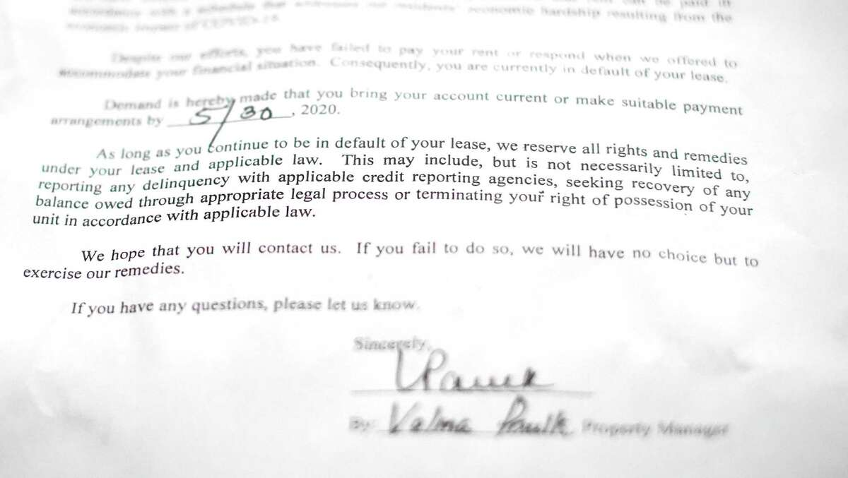 Letters that were placed on Jason Bledsoe's door after he missed rent payments.