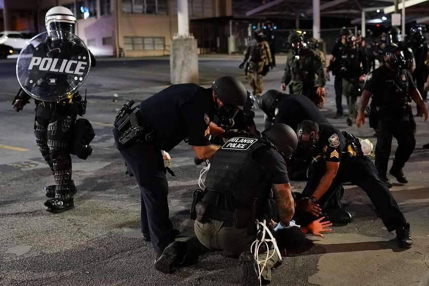 ATLANTA, GA - MAY 30: Police detain a protester during a protest in response to the police killing of George Floyd on May 30, 2020 in Atlanta, Georgia. Across the country, protests have erupted following the recent death of George Floyd while in police custody in Minneapolis, Minnesota in the most recent in a series of deaths of black Americans by the police. (Photo by Elijah Nouvelage/Getty Images)
