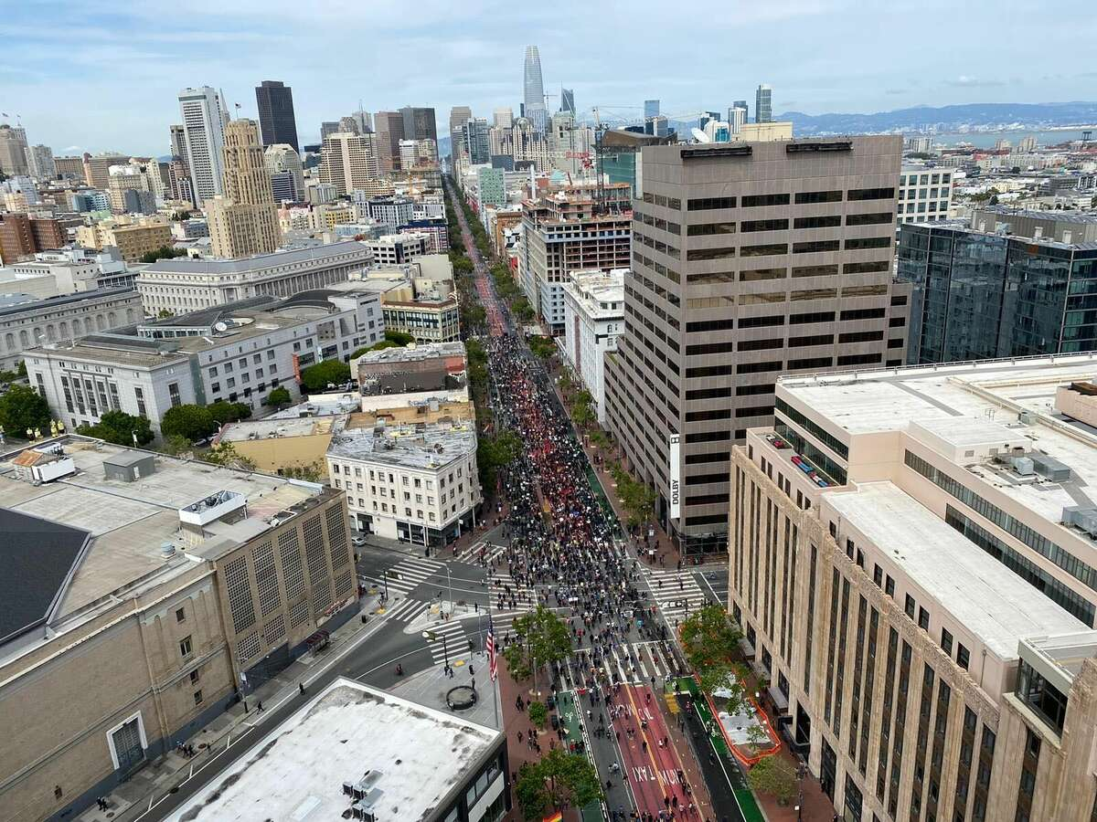 San Francisco residents continued to peacefully march against police brutality and the Memorial Day death of George Floyd on Sunday afternoon, hours before an 8 p.m. curfew will be established in the city.