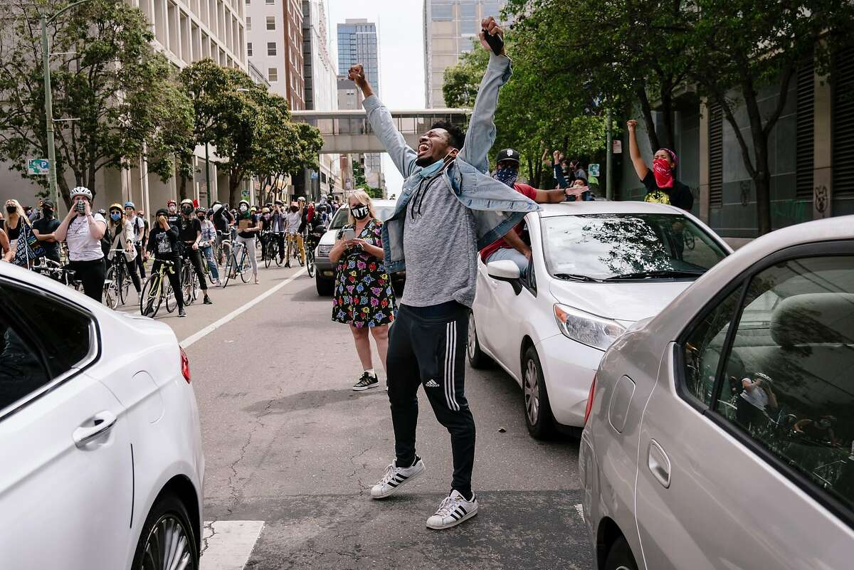 Michael Houston of Oakland chants during a Justice for George Floyd & Breonna Taylor Car Caravan in Oakland, Calif, on Sunday, May 31, 2020.