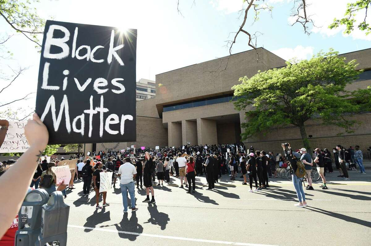 New Haven, Connecticut - Sunday, May 31, 2020: Approximately 1,000 Black Lives Matter protesters and supporters protesting police brutality and the death of George Floyd in Minneapolis Sunday, marched in New Haven Sunday from Broadway to the Green, past Church and blocking the I-95 and I-91 highways near the merge in New Haven in both directions, the Oak Street Connector and then on to New Haven Police Headquarters. As of 5:30 P.M. their were no police confrontations.