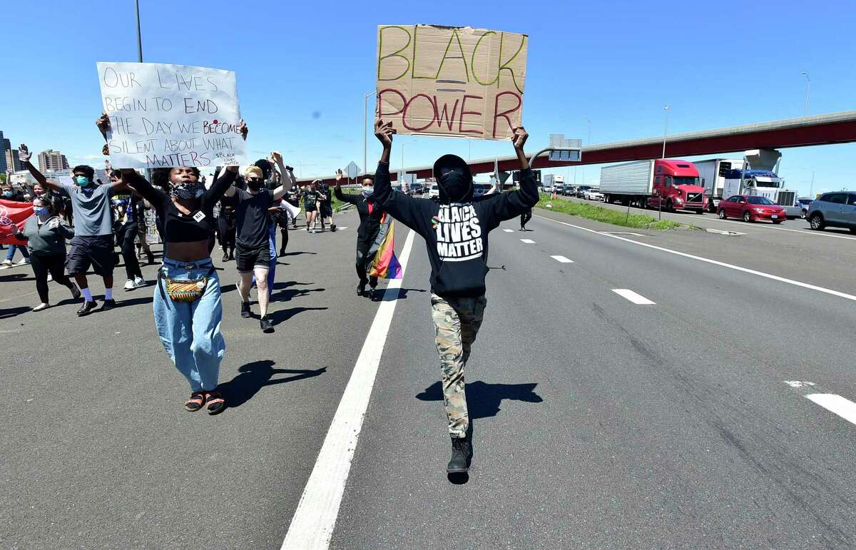 New Haven, Connecticut - Sunday, May 31, 2020: Approximately 1,000 Black Lives Matter protesters and supporters protesting police brutality and the death of George Floyd in Minneapolis Sunday, marched in New Haven Sunday and to the highway blocking the I-95 and I-91 highways in both directions near the merge in New Haven. As of 5:30 P.M. their were no police confrontations.