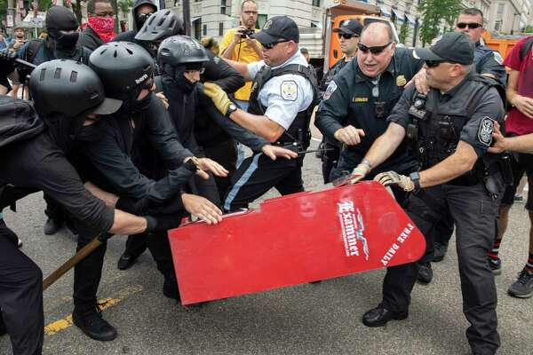 Antifa demonstrators clash with police in Washington in July 2019.