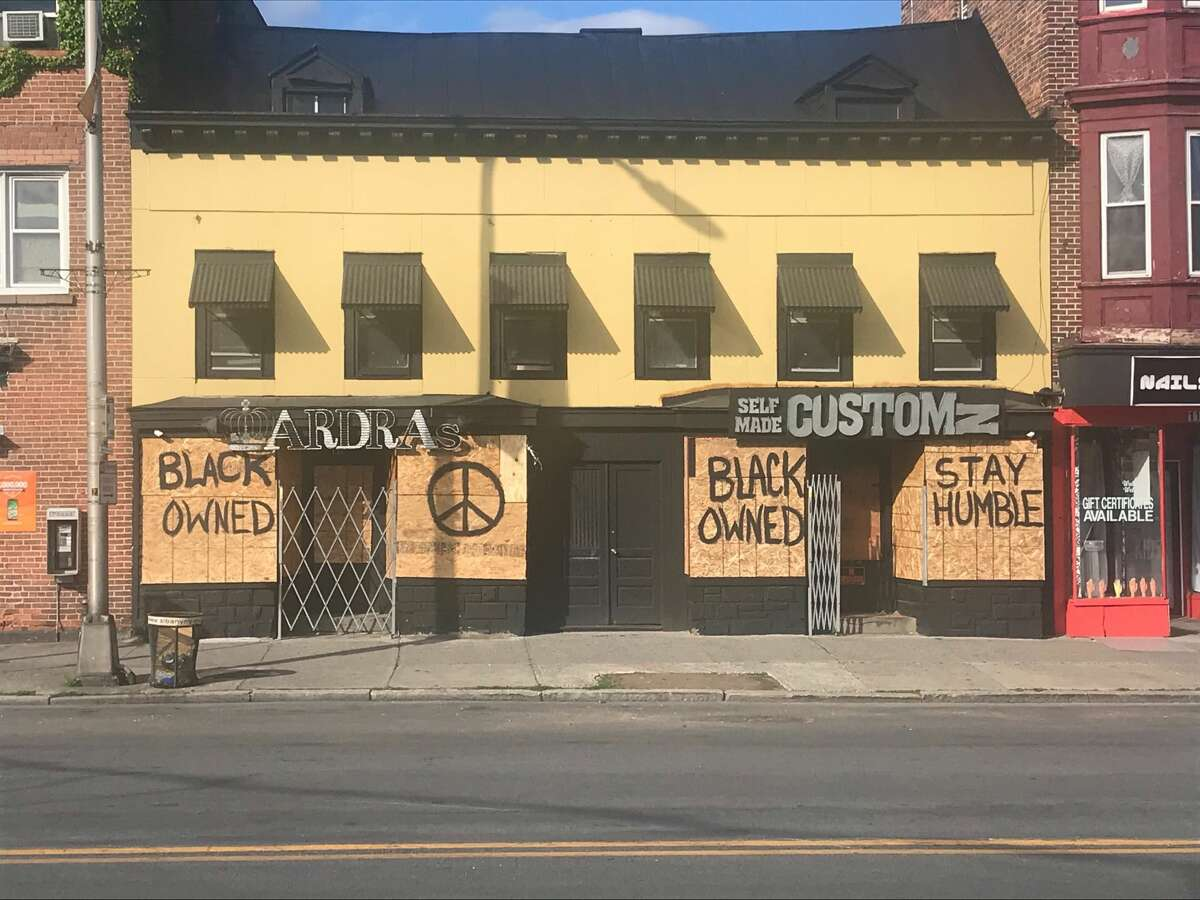 A business tries to prepare in case of more violence in the City of Albany Sunday, May 31, 2020.