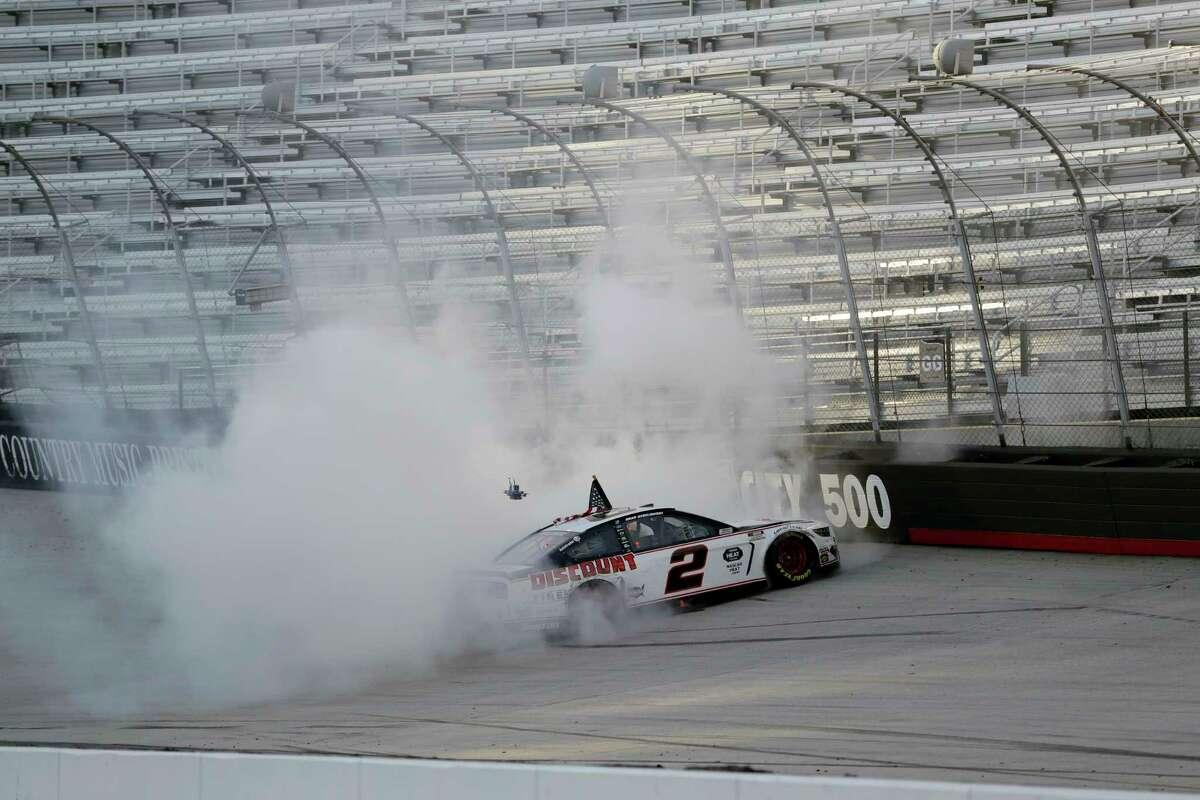 Brad Keselowski (2) does a burnout after winning after winning a NASCAR Cup Series auto race at Bristol Motor Speedway Saturday, May 30, 2020, in Bristol, Tenn. (AP Photo/Mark Humphrey)